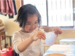 Little girl making a craft