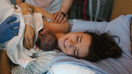New mom holding her newborn in the hospital